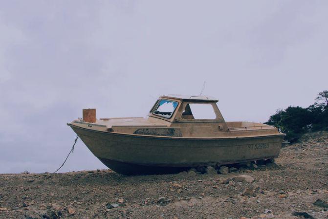 Derelict boat ashore
